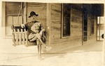 U.S. Army officer smoking on porch at Fort Brown