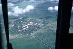 Jungle village from chopper, aerial view by Cayetano E. Barrera