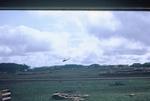 Helicopter landing at Quan-Loi by Cayetano E. Barrera