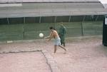 Cayetano Barrera serving ball with dark glasses by Cayetano E. Barrera