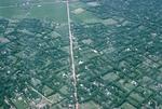 Village near Cu-Chi and road to Saigon by Cayetano E. Barrera