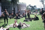 Soldiers beside pool at Quan-Loi after patrol by Cayetano E. Barrera