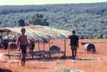"Montagnard tribesmen building ""club"" by Cayetano E. Barrera"