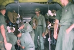 Loading wounded soldiers onto Chinook to go to Saigon by Cayetano E. Barrera