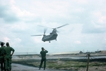 Chinook taking off with soldier shooting photograph of it by Cayetano E. Barrera