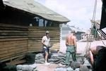 Cayetano Barrera building sandbag bunker by Cayetano E. Barrera