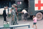 Mrs. Dow giving shot at ARVN compound by Cayetano E. Barrera