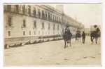 Mexican army soldiers on guard in front of National Palace while Liberation Army of the South (Zapatistas) soldiers are on horseback