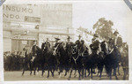 Mexican Army soldiers and generals on horseback riding through Mexico City streets