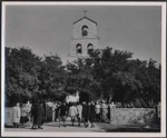 Photograph of a multitude of people entering the Shary Chapel