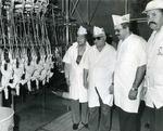 Photograph of Kika de la Garza on tour of Pollo Picu processing plant