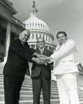 Photograph of Kika de la Garza with two other dignitaries in front of United States Capitol