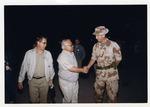 Photograph of Kika de la Garza shaking hands of a Marine