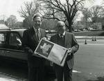 Photograph of Kika de la Garza with Congressman J. J. Pickle holding a box of onions from Duda & Sons