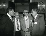 Photograph of Kika de la Garza with Julius Collins, Guy Pete, and Congressman J. J. Pickle at shrimper's meeting