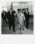 Photograph of Kika de la Garza with President Lyndon B. Johnson accessing damage caused by Hurricane Beulah