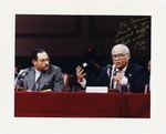 Photograph of Kika de la Garza beside United States Secretary of Agriculture, Mike Espy at a roundtable