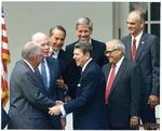 Photograph of Kika de la Garza with President Ronald Reagan and United States Senators
