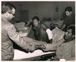 Photograph of Kika de la Garza visiting soldiers at U.S. Army 3rd Field Hospital / Saigon Adventist Hospital
