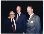 Photograph of Kika de la Garza with President George H. W. Bush and United States Representative Sonny Montgomery