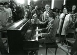 Photograph of President Richard Nixon playing Happy Birthday on the piano for Kika de la Garza
