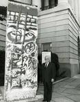 Photograph of Kika de la Garza beside a section of the Berlin Wall known as Bloody Erich