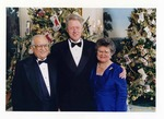 Photograph of Kika de la Garza and wife Lucille with President Bill Clinton during Christmas at the White House