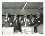 Photograph of Kika de la Garza with various dignitaries holding up Ruby Sweet Grapefruit