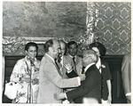 Photograph of Kika de la Garza greeting another dignitary at a conference