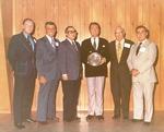 Photograph of Kika de la Garza standing beside a man who received an award