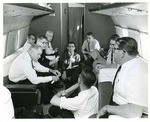 Photograph of dignitaries on a private jet en route to Washington D.C from Mission, Texas