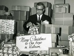 Photograph of Kika de la Garza wrapping Christmas care packages for soldiers in Vietnam