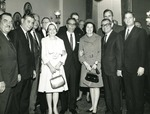 Photograph of Kika de la Garza with various dignitaries at a Democratic National Congressional Committee meeting